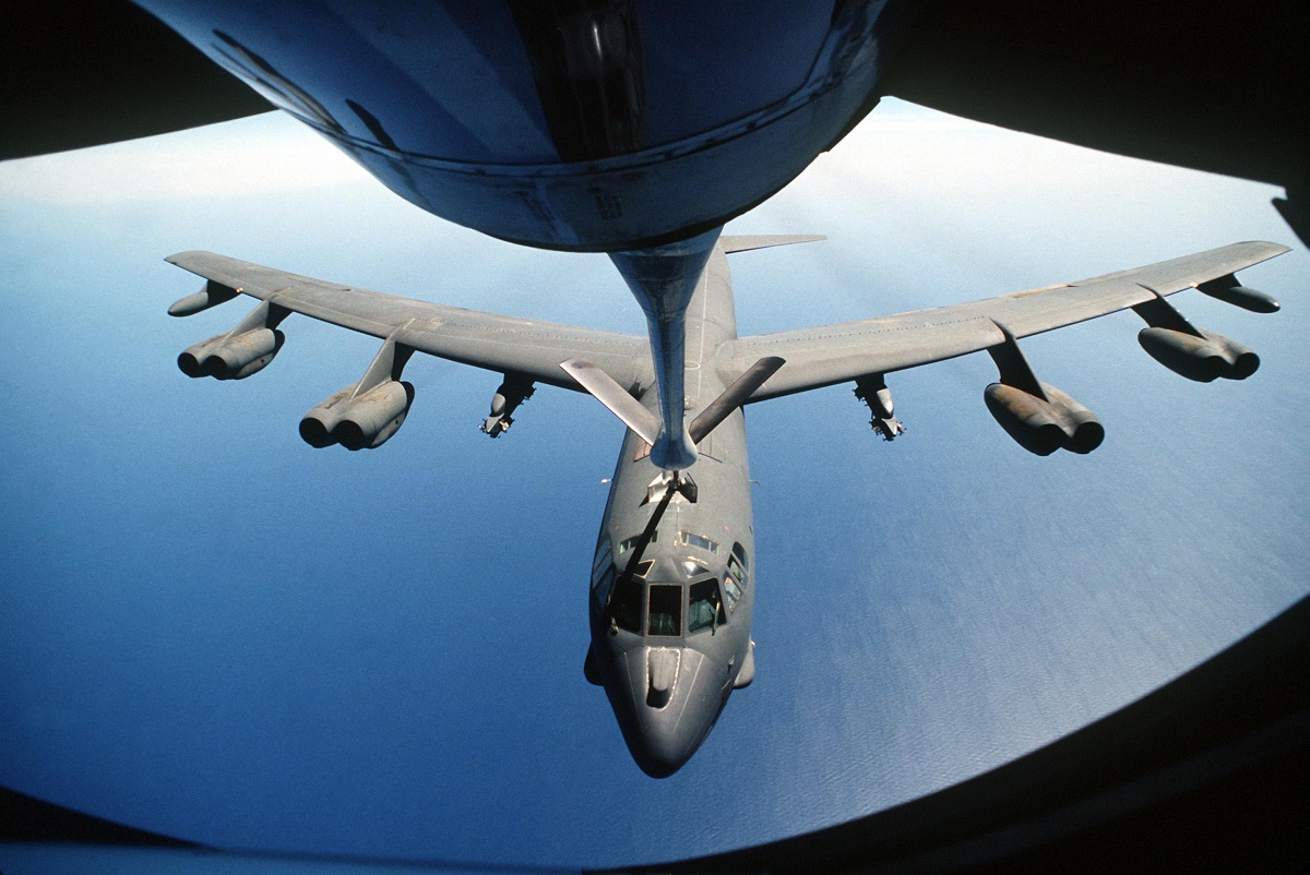 A KC-135 Stratotanker aircraft boom operator refuels a B-52 Stratofortress aircraft, center, during air operations for Operation Desert Storm over Southwest Asia Feb. 1, 1991. (U.S. Air Force photo by Senior Airman Chris Putnam/Released)