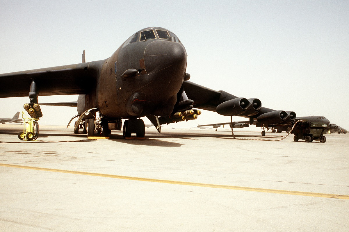 A B-52G Stratofortress aircraft is serviced on the flight line prior to flying a bombing mission against Iraqi forces during Operation Desert Storm. The aircraft is armed with M-117 750-pound bombs.