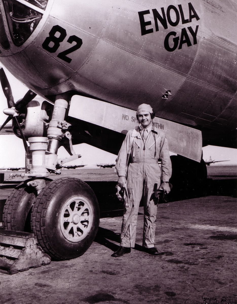 """Paul Tibbetts, Jr., of Miami, Fla., poses in front of his B-29  Superfortress """"The Enola Gay"""" (named for his mother). The Enola Gay is ..."""