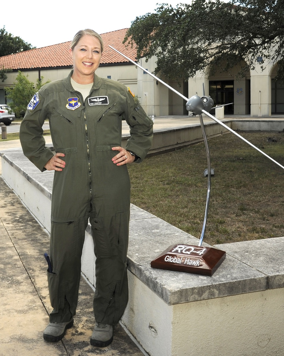 Tech. Sgt. Courtney poses for a photo before the 558th Flying Training Squadron's Undergraduate Remotely Piloted Aircraft Training Course graduation Aug. 4, 2017, at Joint Base San Antonio-Randolph, Texas.