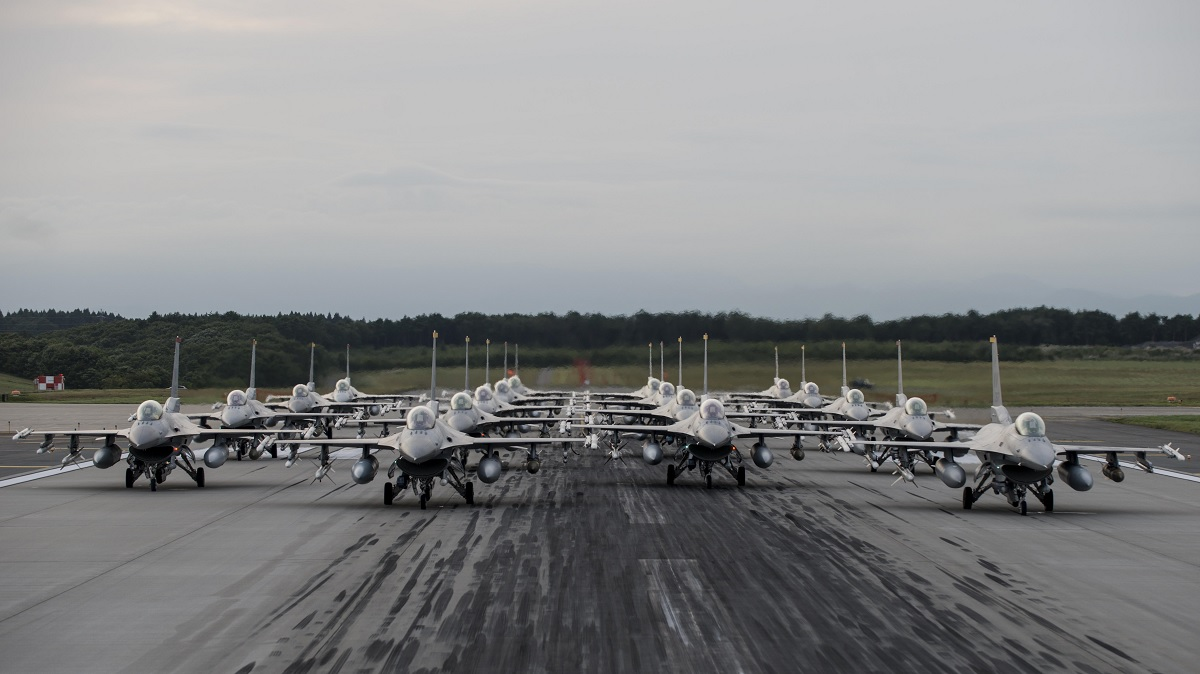 18 fully armed F-16 Fighting Falcon fighter bombers conduct elephant walk exercise at Misawa Air Base