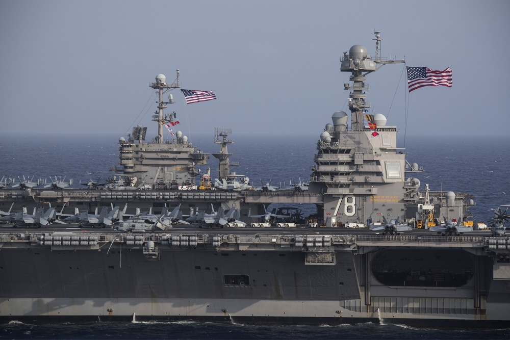 These photos of USS Gerald R. Ford and USS Harry S. Truman operating together highlight the differences between a Ford-class and a Nimitz-class aircraft carrier