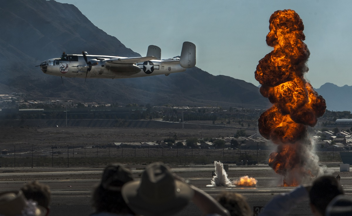 A B-25 Mitchell World War II bomber aircraft flies in front of the crowd during an air-to-ground demonstration at the Aviation Nation air show on Nellis Air Force Base, Nev., Nov. 13, 2016. The many aerial acts and static aircraft displayed during the Nellis Air Show are snapshots of 75 years of aviation history. (U.S. Air Force photo by Airman 1st Class Kevin Tanenbaum/Released)