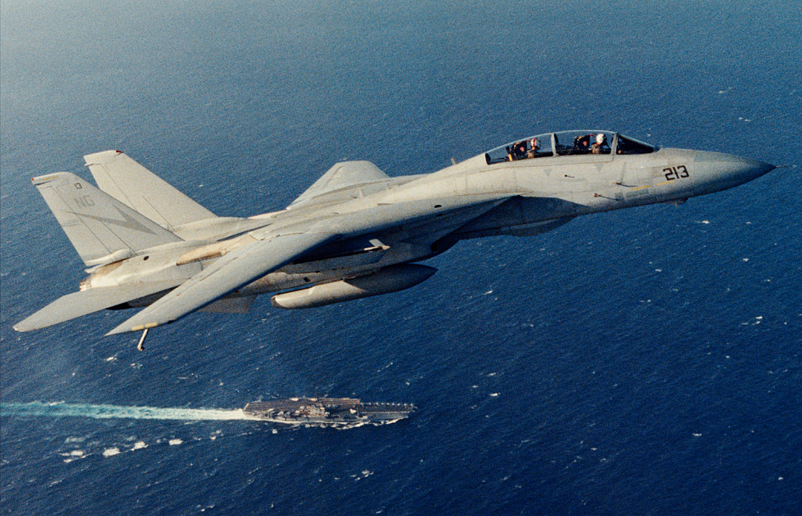 NG213 / 160888 cruises above USS Ranger on a routine flight.