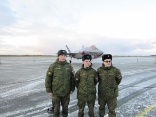 Russian Military observers pose for a picture in front of Norway's F-35