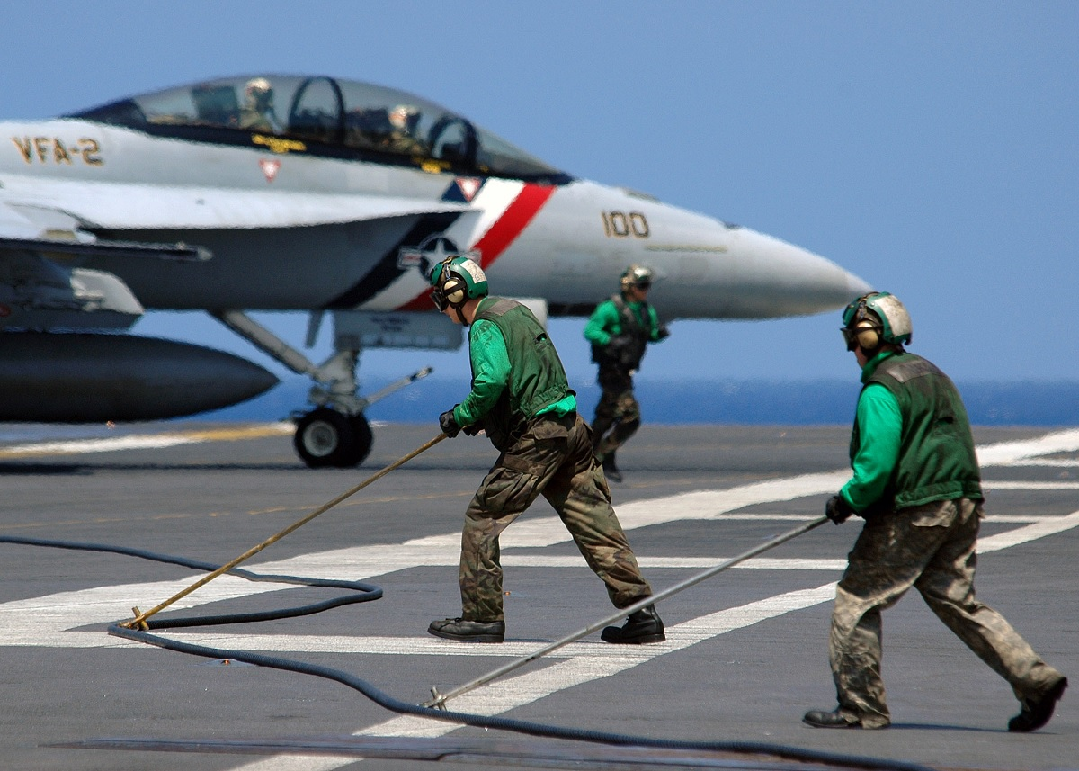 U.S. Naval Aviators complete their 1000th trap flying together