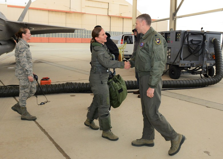Maj. Rachael Winiecki, 461st Flight Test Squadron F-35 test pilot (left), and Airman 1st Class Heather Rice, 412th Aircraft Maintenance Squadron crew chief, pose for a photo right after Winiecki landed her F-35 Lightning II on her first test mission flight in the fifth-generation fighter Dec. 14, 2018.