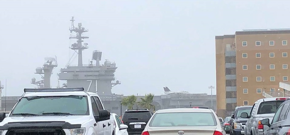 F-14 Tomcat aboard USS Theodore Roosevelt for Top Gun Sequel filming shifts on the deck