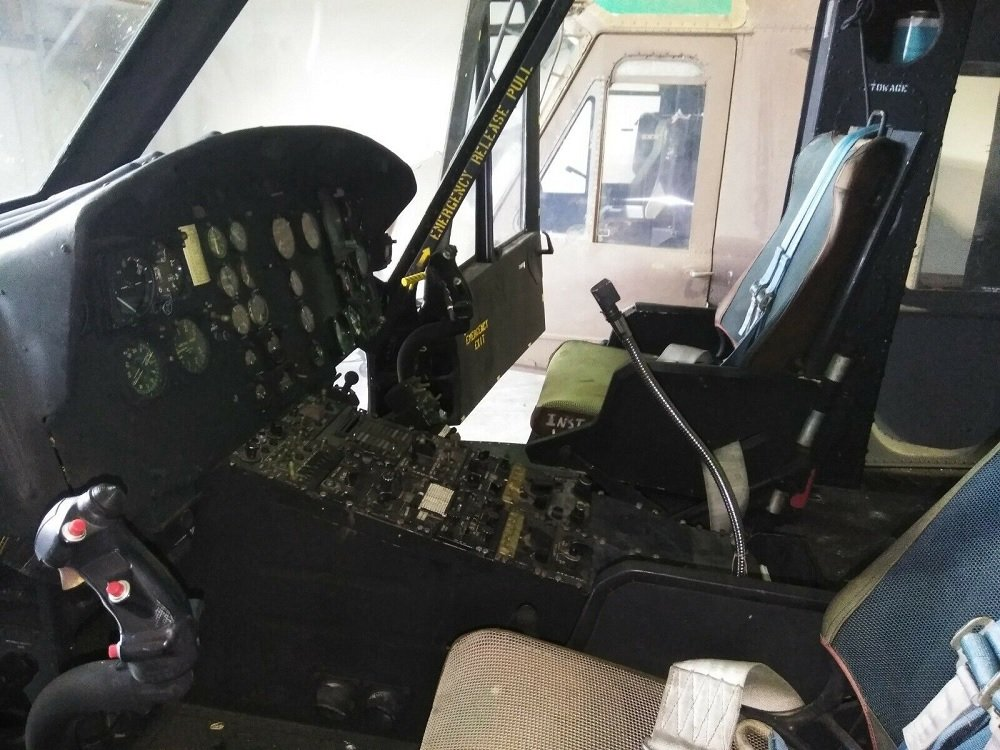 This Vietnam Era UH-1 Huey Helicopter is offered for sale on eBay