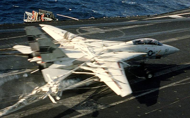 Photo Sequence shows F-14A Tomcat Engaging Barricade during Emergency Landing aboard USS Kitty Hawk