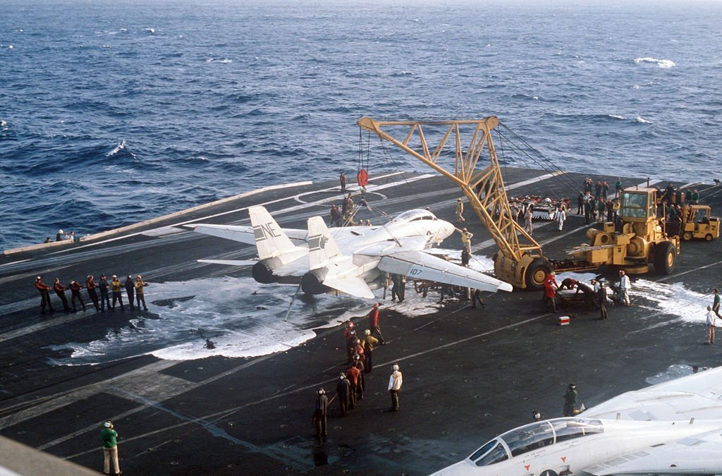Photo sequence shows F-14A Tomcat Engaging Barricade during Emergency Landing aboard USS Kitty Hawk 35 Years Ago