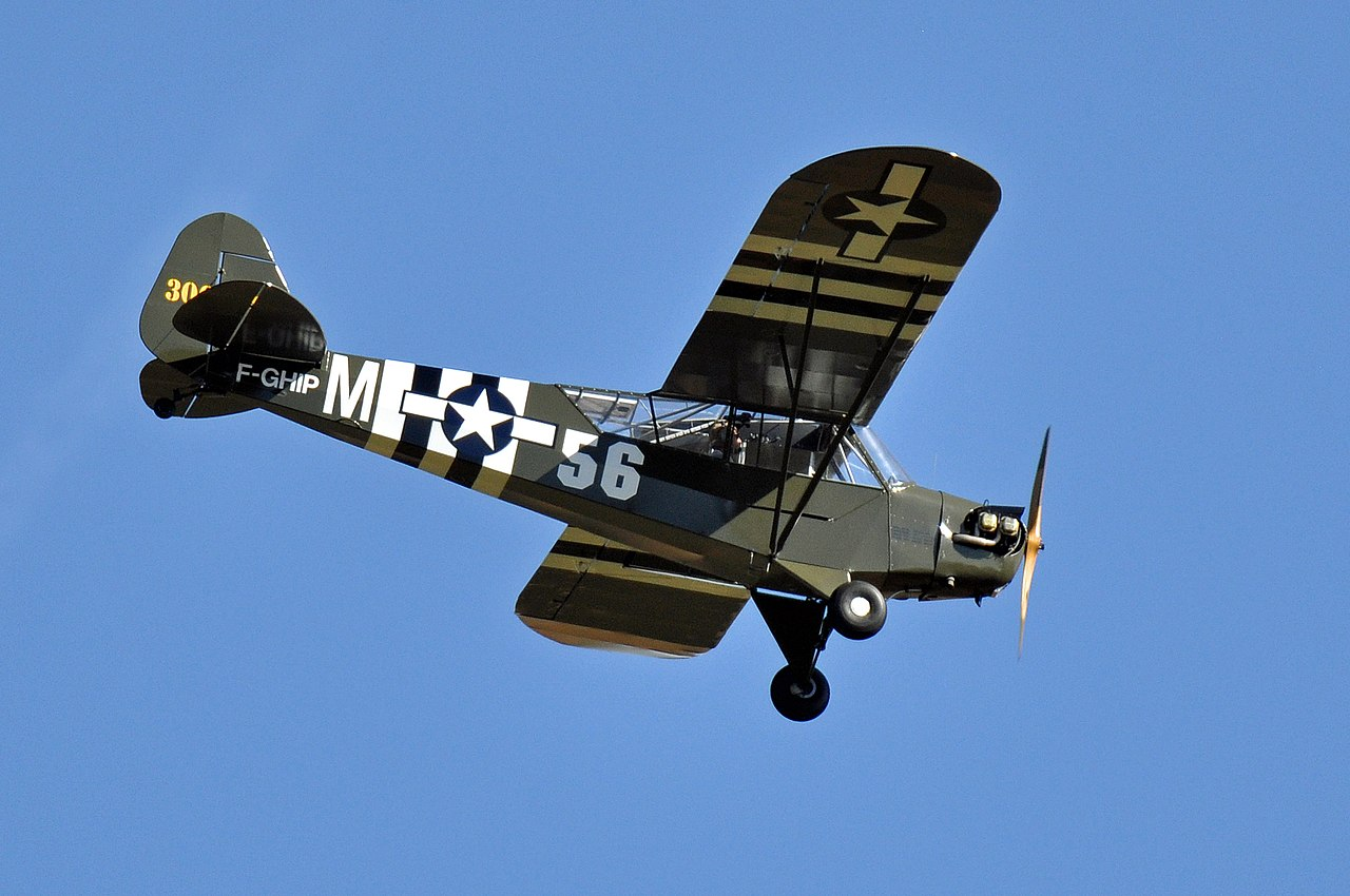 The story of the Piper L-4H Grasshopper crew that used their Colt. 45 Pistols to shoot down a Fieseler Fi 156 Storch