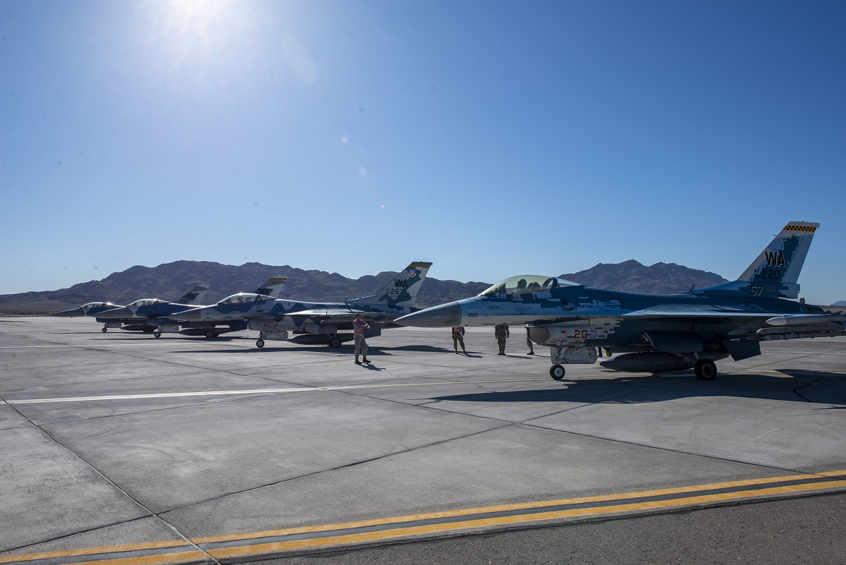 Vegas Goes Blue: 64th Aggressor Squadron flies training mission using all blue F-16s to symbolize Nellis appreciation for COVID-19 First Responders