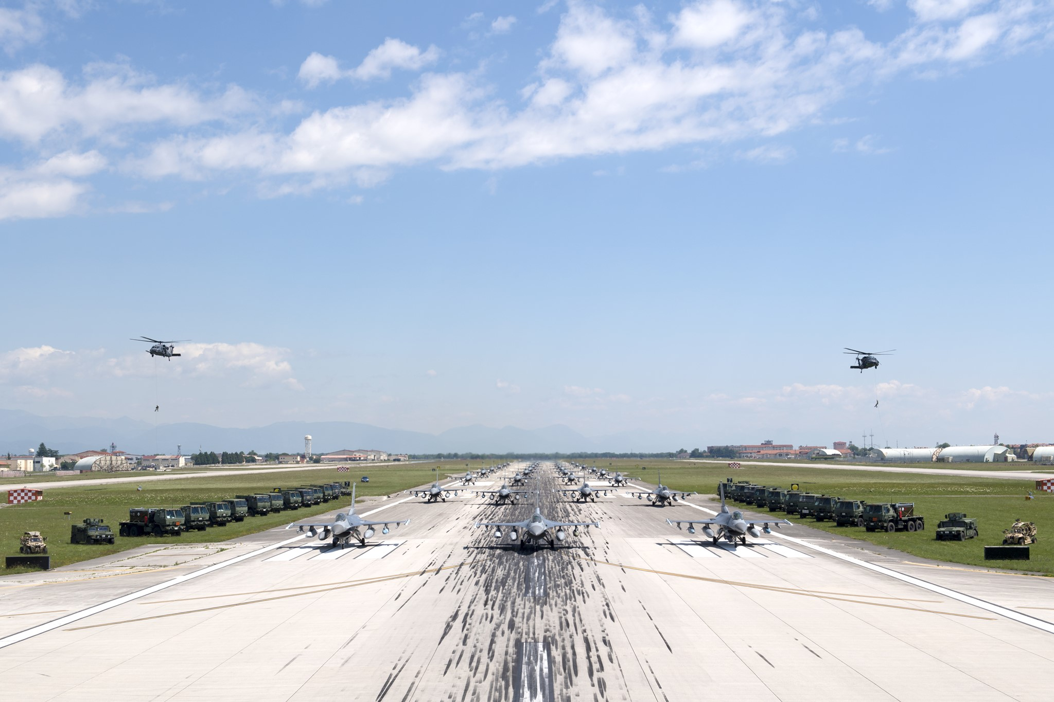 Aviano F-16s and HH-60Gs conduct Elephant Walk and COVID-19 flyover