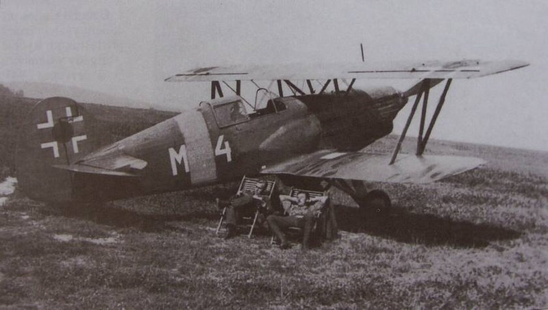 During WWII a Slovak Air Force's biplane pilot rescued a downed fellow pilot by carrying him on the bottom wing of his aircraft