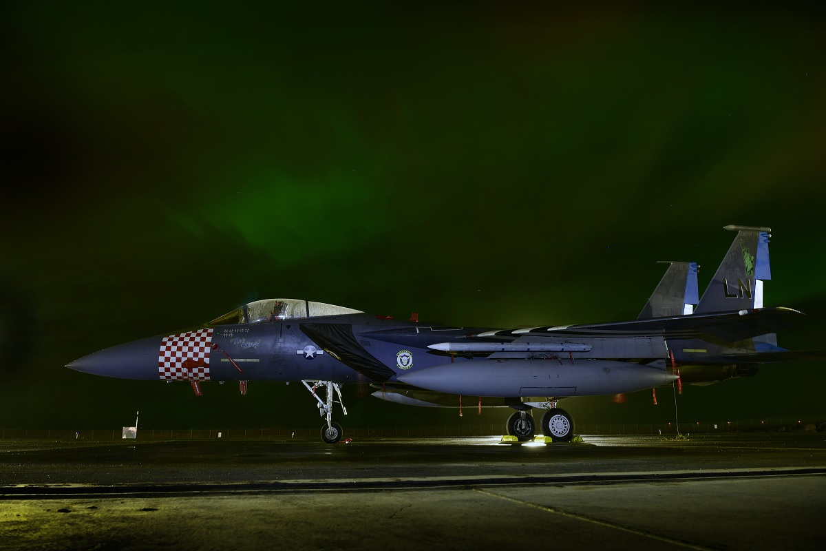 "Cool photos show ""The King,"" the last of the 48th FW's Heritage F-15 aircraft, in the green light of the Aurora Borealis"
