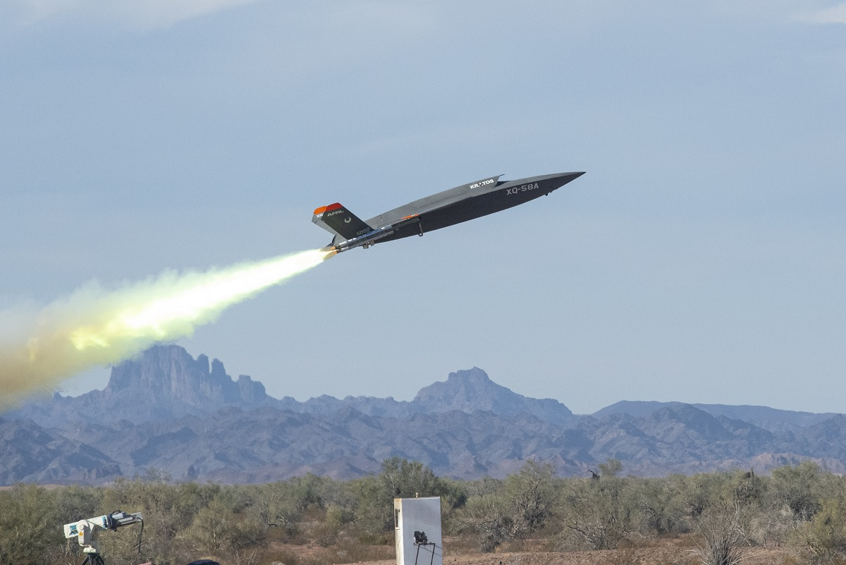 F-22 Raptor and F-35 Lightning II fly in formation with the XQ-58A Valkyrie for the first time